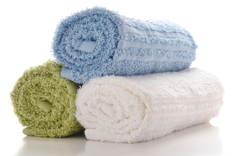 Soft and fluffy rolled up cotton towels ideal for drying shih tzu.